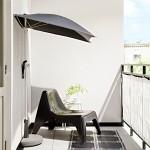 Gartensessel und Sonnenschirm