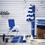 Gartenstuhl, Sonnenschirm und Teppich